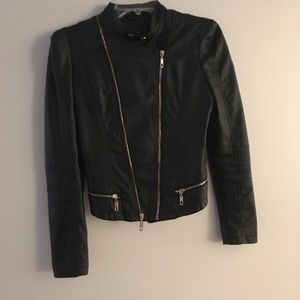 Faux leather jacket with two sided zip closure